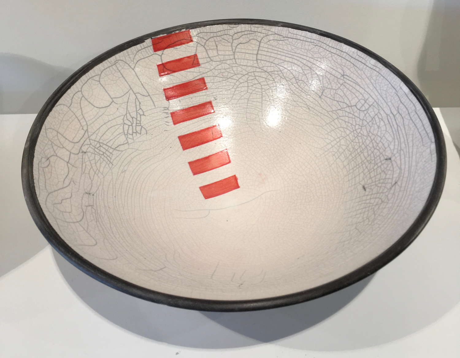White bowl with red