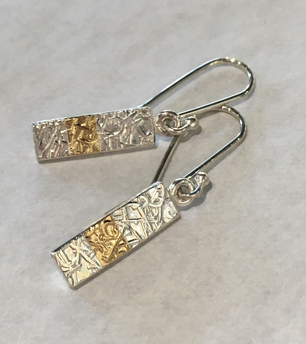 Text-ure earrings (oblong with gold band)
