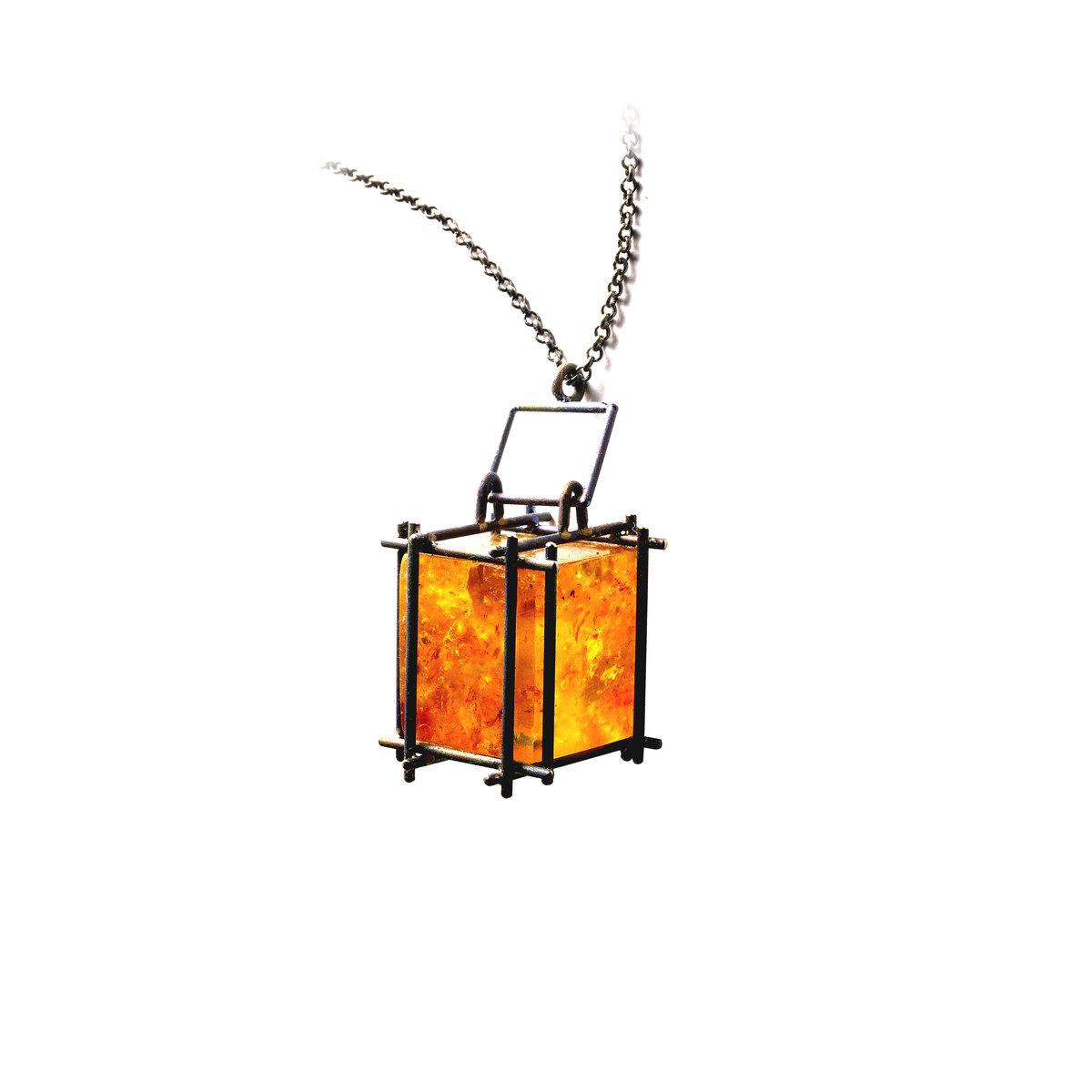 Kauri Gum and Titanium pendant NA110