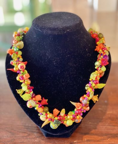 Multi colour necklace with red leaves and flowers