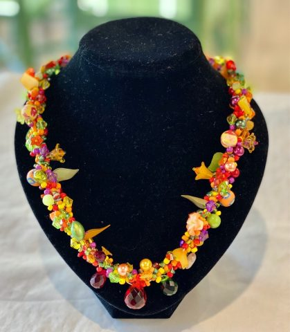 Multi colour necklace  with facet red/green drops