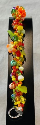 Narrow band bracelet (multi colour with purple and white striped bead)