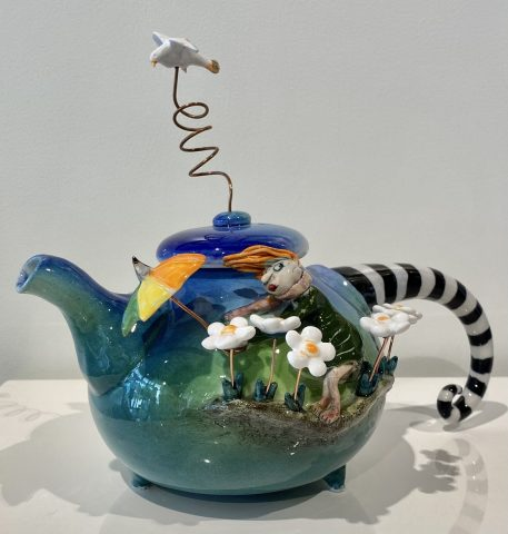 Teapot - girl with umbrella on side of pot