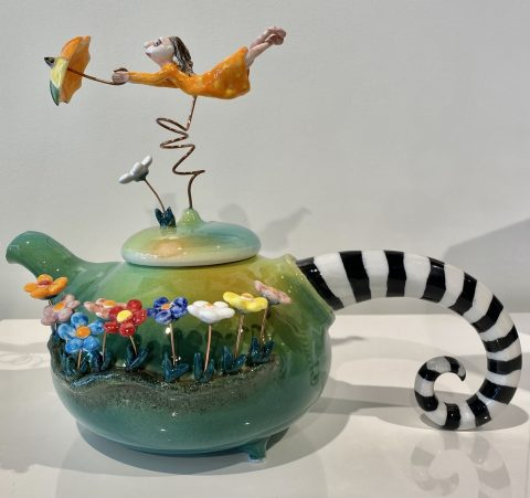 Teapot - girl with umbrella on lid
