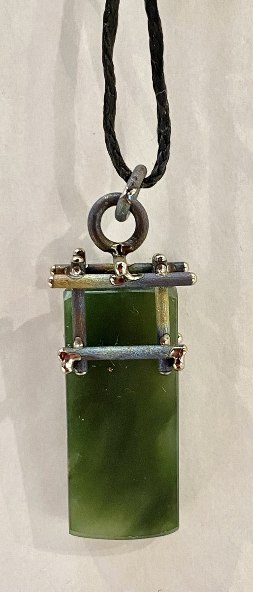 NA133- Pounamu, titanium and sterling silver pendant