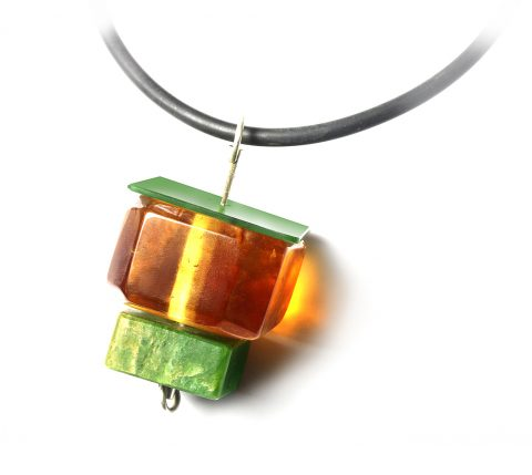 NA125- Pounamu, Kauri Gum and sterling silver pendant on rubber