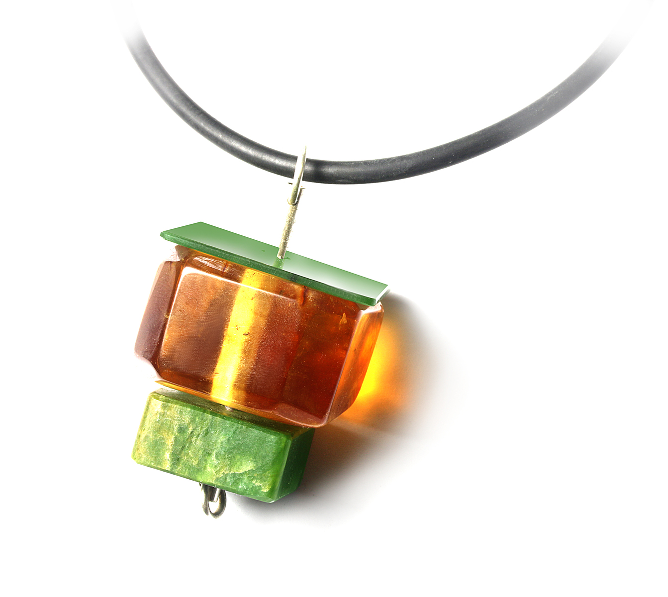 NA125- Pounamu, Kauri Gum and sterling silver pendant on rubber
