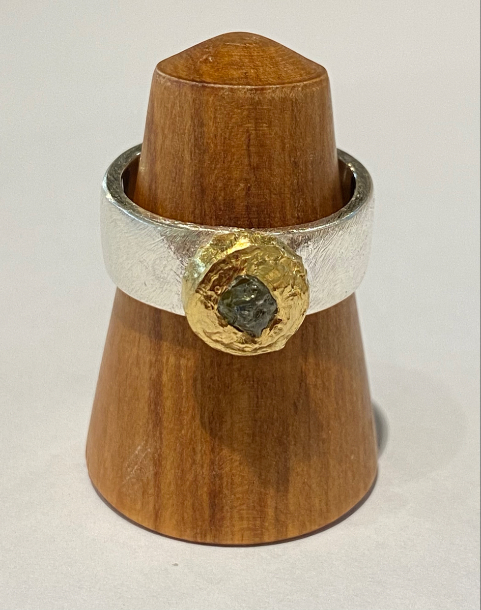 Sterling silver ring with green sapphire (22ct gold bezel)