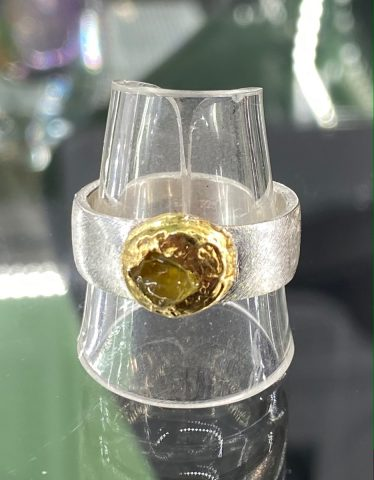 Sterling silver ring with yellow sapphire (22ct gold bezel)