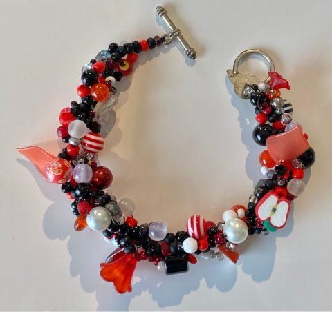 Bracelet - narrow - reds, blacks, flowers and cut apple