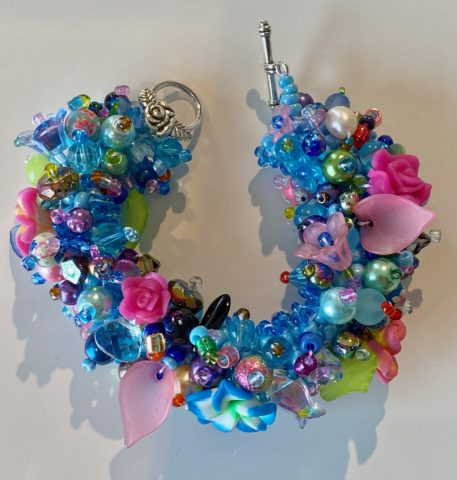 Bracelet - wide - multi coloured blue with pink flowers