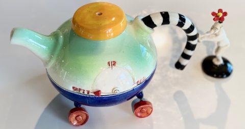 Teapot - Sitting on Empty- on wheels (separate man pushing teapot)